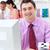 Portrait of a confident businessman working at his computer  stock photo © wavebreak_media