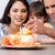 moeder · dochter · verjaardagstaart · glimlachend · voedsel · kinderen - stockfoto © wavebreak_media