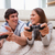 happy young couple playing video games together stock photo © wavebreak_media