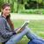 lächelnd · Mädchen · halten · Buch · Sitzung · Gras - stock foto © wavebreak_media