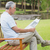 relaxed senior man reading newspaper at park stock photo © wavebreak_media