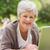 smiling senior woman using laptop at park stock photo © wavebreak_media