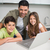 Smiling father with young kids using laptop in kitchen stock photo © wavebreak_media