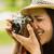 happy brunette taking photo with retro camera stock photo © wavebreak_media