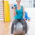smiling young woman exercising with dumbbells on fitness ball stock photo © wavebreak_media