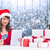 composite image of festive brunette shopping online with tablet stock photo © wavebreak_media