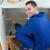 Smiling repair man measuring something in a kitchen stock photo © wavebreak_media