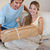 Portrait of a couple looking at a package in their living room stock photo © wavebreak_media