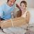 portrait · couple · regarder · paquet · salon · maison - photo stock © wavebreak_media