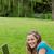 młoda · dziewczyna · trawy · parku · wpisując · laptop · śmiechem - zdjęcia stock © wavebreak_media