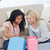 two women sitting on the floor with shopping bags are smiling stock photo © wavebreak_media