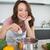 souriant · jeune · femme · cuisine · portrait · maison - photo stock © wavebreak_media