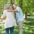 mature man assisting woman with walker at park stock photo © wavebreak_media