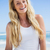 gorgeous blonde smiling at camera on the beach stock photo © wavebreak_media