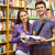 smiling friends student holding textbook stock photo © wavebreak_media