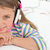 Little gril listening to music with headphones lying on her bed stock photo © wavebreak_media