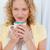 Pretty woman drinking coffe in her kitchen at home stock photo © wavebreak_media