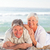 elderly couple lying down on the beach stock photo © wavebreak_media