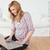 Attractive woman surfing on her laptop sitting on the floor stock photo © wavebreak_media
