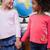 портрет · улыбаясь · школьницы · , · держась · за · руки · классе · мира - Сток-фото © wavebreak_media