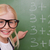 Smart schoolgirl pointing at something on a blackboard stock photo © wavebreak_media