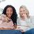 iki · kadın · oturma · aşağı · bakıyor · kamera · patlamış · mısır - stok fotoğraf © wavebreak_media