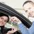 man giving car keys to a woman thru a window stock photo © wavebreak_media