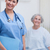 Smiling nurse holding a folder in hospital ward stock photo © wavebreak_media