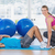 female trainer helping man with his exercises at gym stock photo © wavebreak_media
