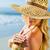 Gorgeous blonde in bikini applying suncream on the beach stock photo © wavebreak_media