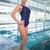 mooie · jonge · vrouw · permanente · zwembad · vrouwen · schoonheid - stockfoto © wavebreak_media