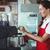pretty barista using the coffee machine stock photo © wavebreak_media