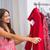 mosolygó · nő · néz · ruházat · butik · lány · kéz - stock fotó © wavebreak_media