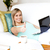 Charming woman surfing the internet lying on a sofa stock photo © wavebreak_media
