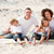 family playing sitting on a beach stock photo © wavebreak_media