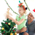 Cute little girl decorating the christmas tree with her father at home stock photo © wavebreak_media