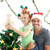 Happy father and daughter decorating together the christmas tree at home stock photo © wavebreak_media