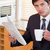 portrait of a businessman drinking tea while reading a newspaper in his kitchen stock photo © wavebreak_media