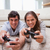 young couple playing video games in the living room stock photo © wavebreak_media