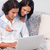 Young couple booking holidays online stock photo © wavebreak_media