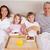 семьи · завтрак · спальня · глядя · камеры · улыбка - Сток-фото © wavebreak_media