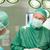 mosolyog · sebész · néz · kolléga · sebészi · szoba - stock fotó © wavebreak_media