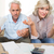 tensed mature couple with bills and calculator at home stock photo © wavebreak_media