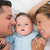 cute baby with parents in bed stock photo © wavebreak_media