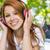 sorridente · feliz · mulher · ouvir · música · ao · ar · livre · estômago - foto stock © wavebreak_media