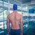 rear view of shirtless swimmer by pool at leisure center stock photo © wavebreak_media