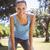 gyönyörű · karcsú · nő · súlyzók · zenét · hallgat · testmozgás - stock fotó © wavebreak_media