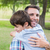 father and son hugging in the park stock photo © wavebreak_media