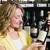 smiling pretty blonde woman showing a wine bottle stock photo © wavebreak_media