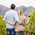 rear view of a young happy couple holding glasses of wine stock photo © wavebreak_media